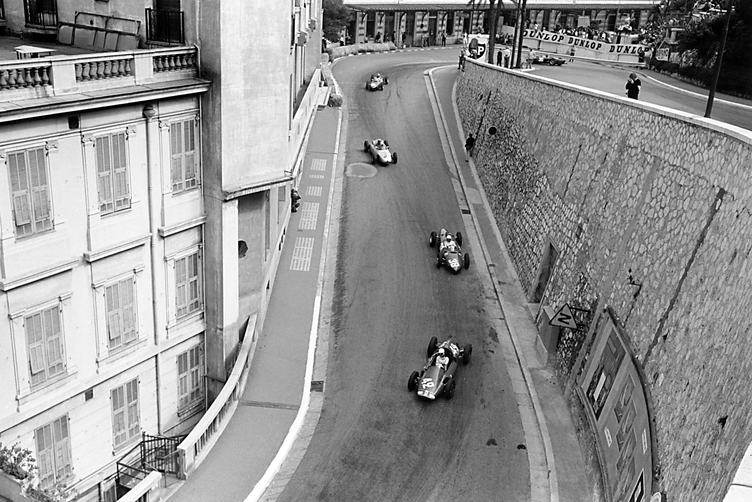 Maurice Trintignant (Cooper T51-Maserati) leads Phil Hill (Ferrari 156), Jo Bonnier (Porsche 787), Wolfgang von Trips and Richie Ginther (both Ferrari 156) out of the Old Station Hairpin.