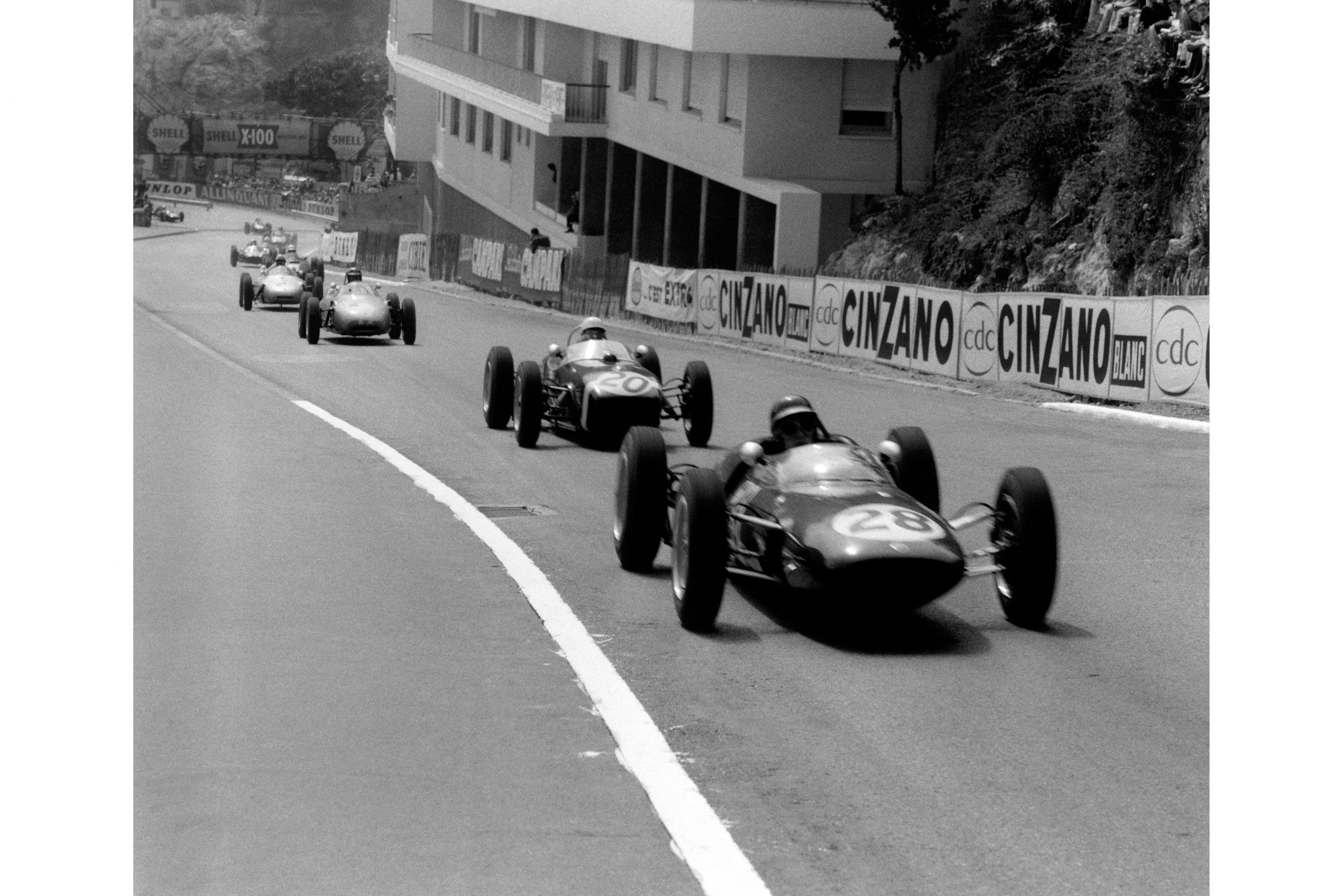 Jim Clark in a Lotus 21-Climax leads Stirling Moss driving a Lotus 18-Climax.
