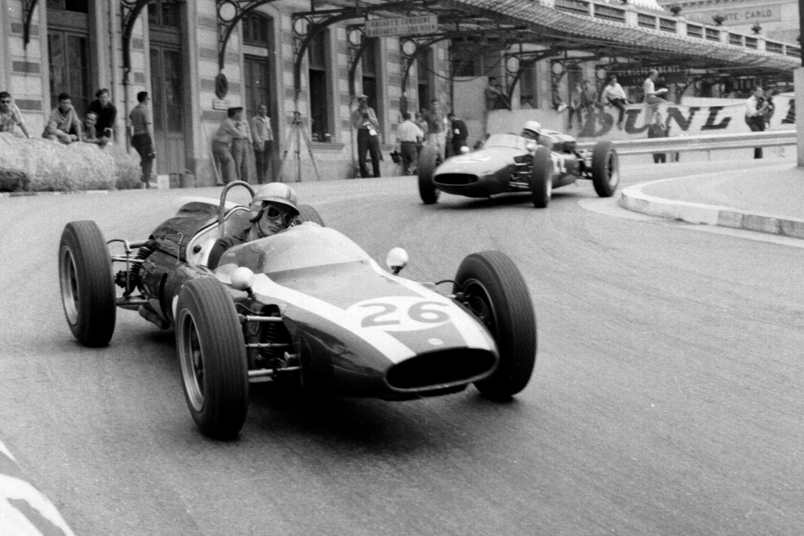 Bruce McLaren in a Cooper T55 Climax leads John Surtees at the wheel of a Cooper T53 Climax out of Station Hairpin.