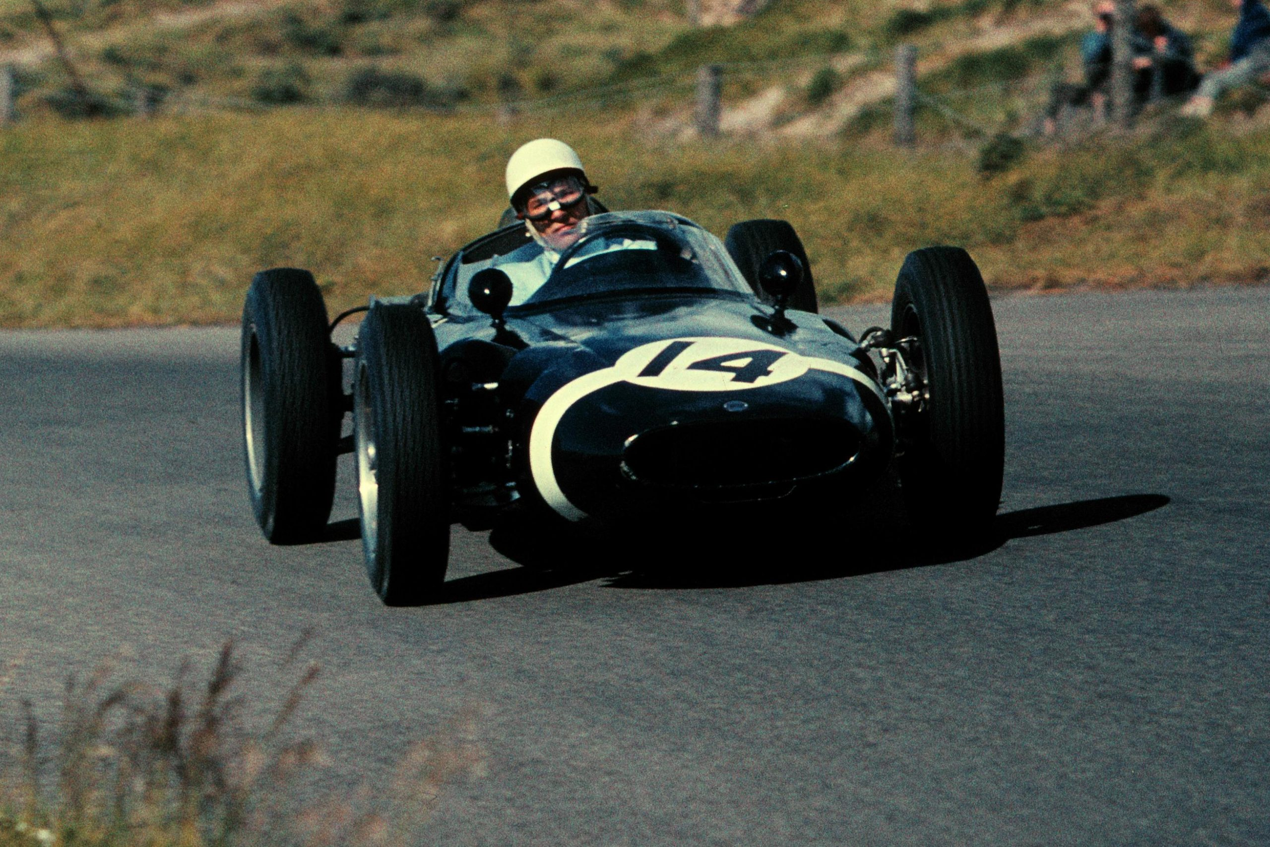 Stirling Moss driving a Lotus 18 to 4th place.