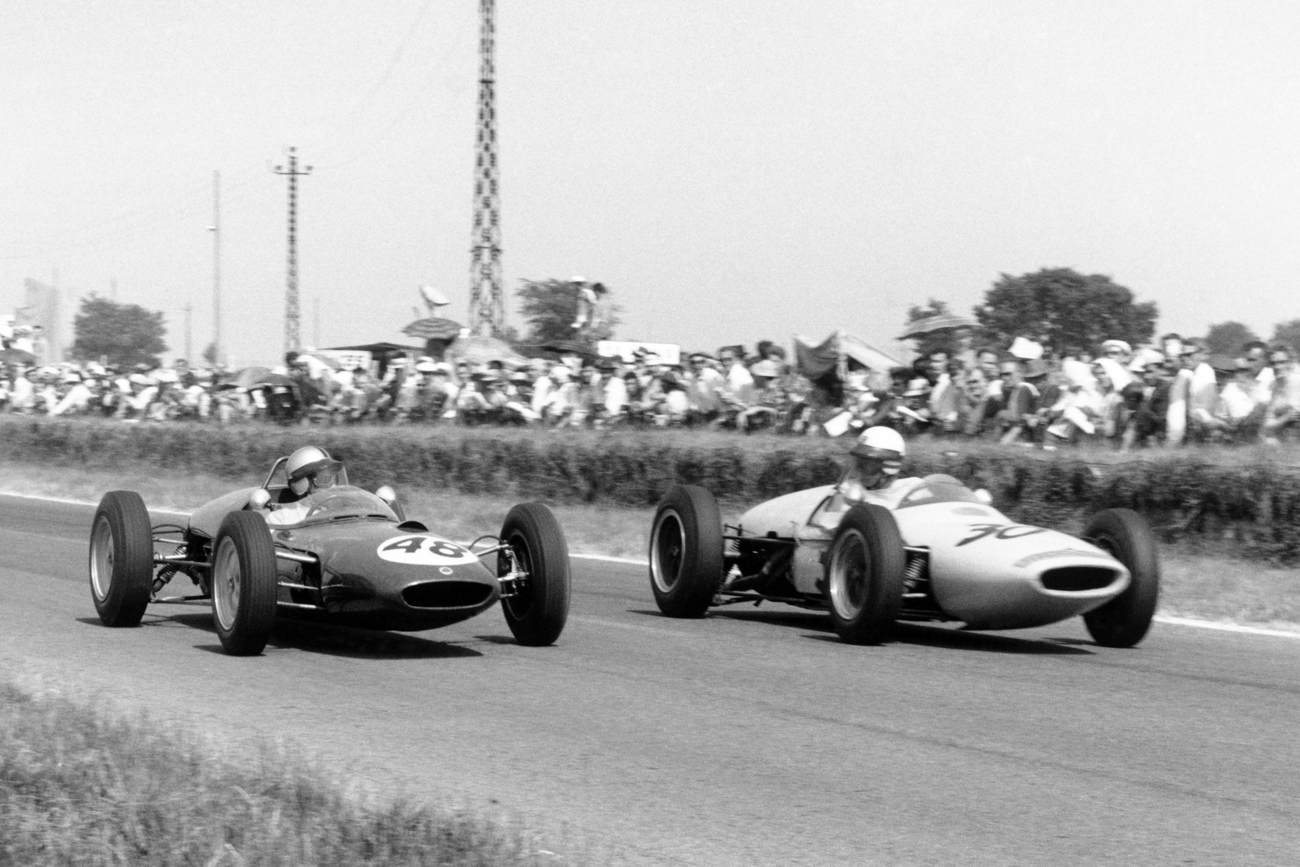 Willy Mairesse in #48 Lotus 21-Climax and Henry Taylor in #30 Lotus 18/21-Climax.
