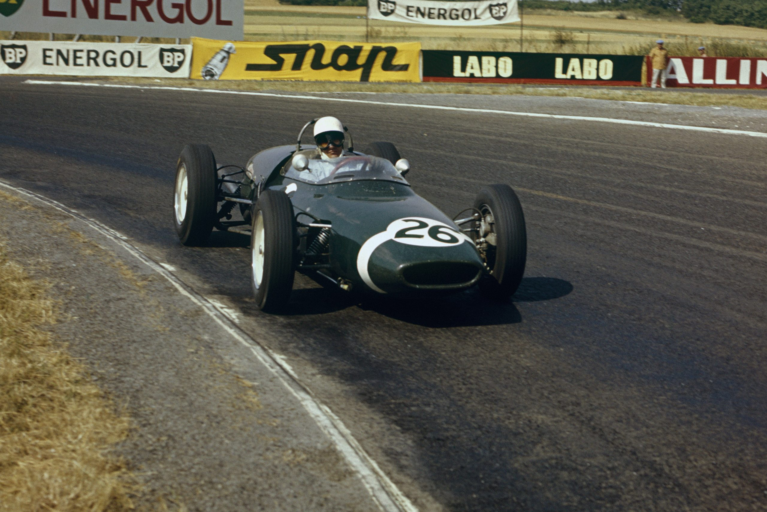Stirling Moss in his Lotus 18/21 Climax, he later retired from the race.