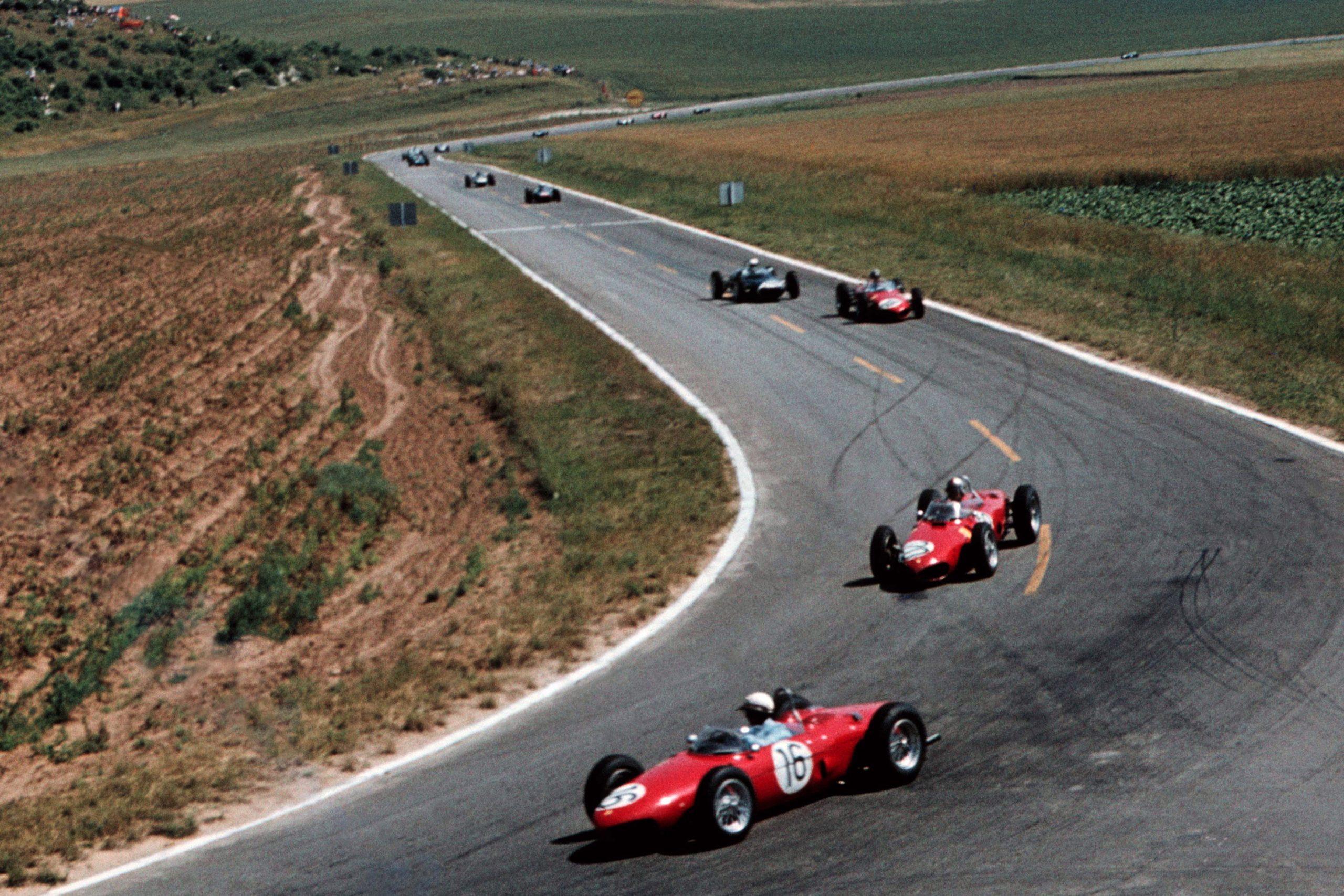 Phil Hill leads team mate Wolfgang von Trips in their Ferrari 156s.
