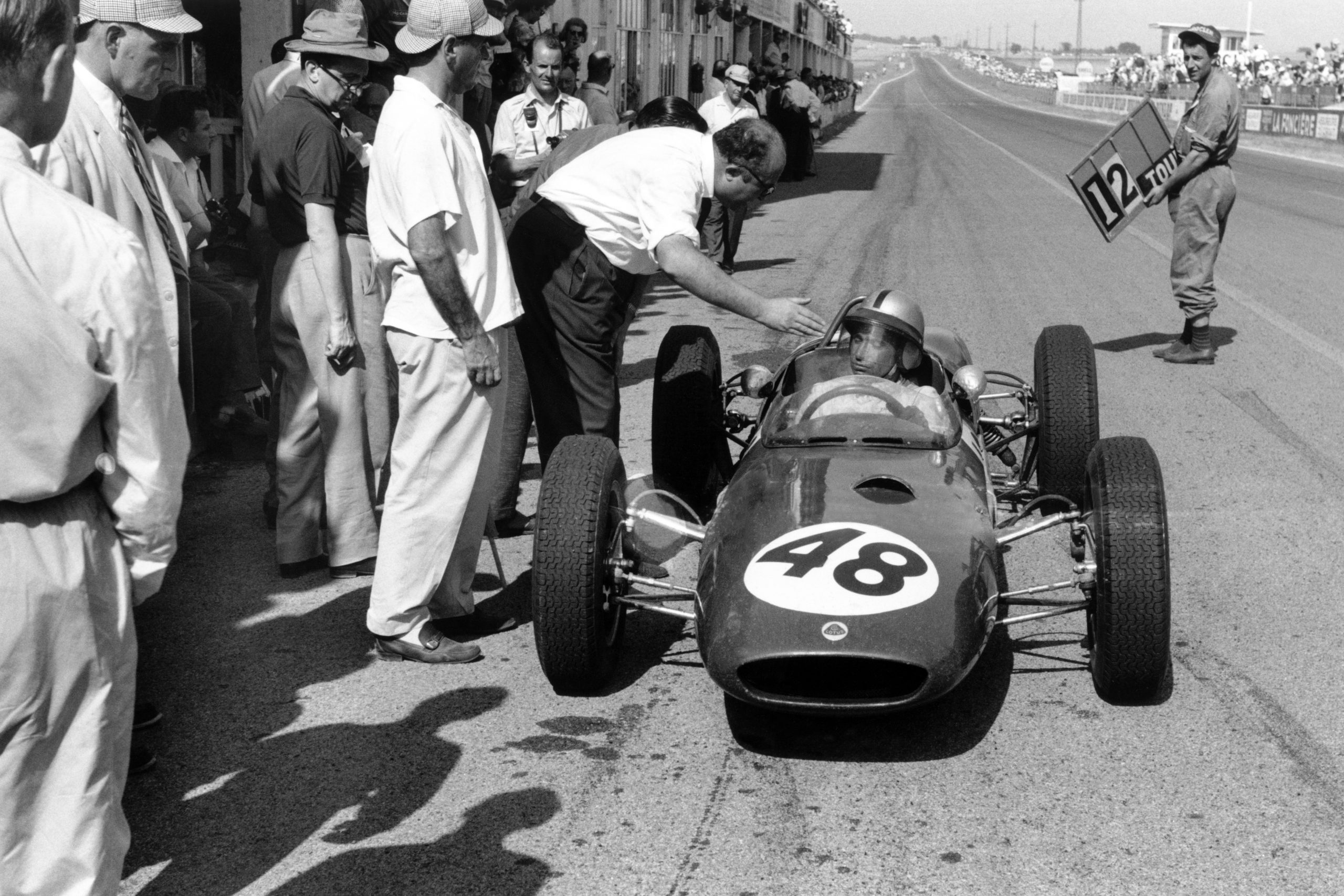 Willy Mairesse's Lotus 21-Climax in the pits.