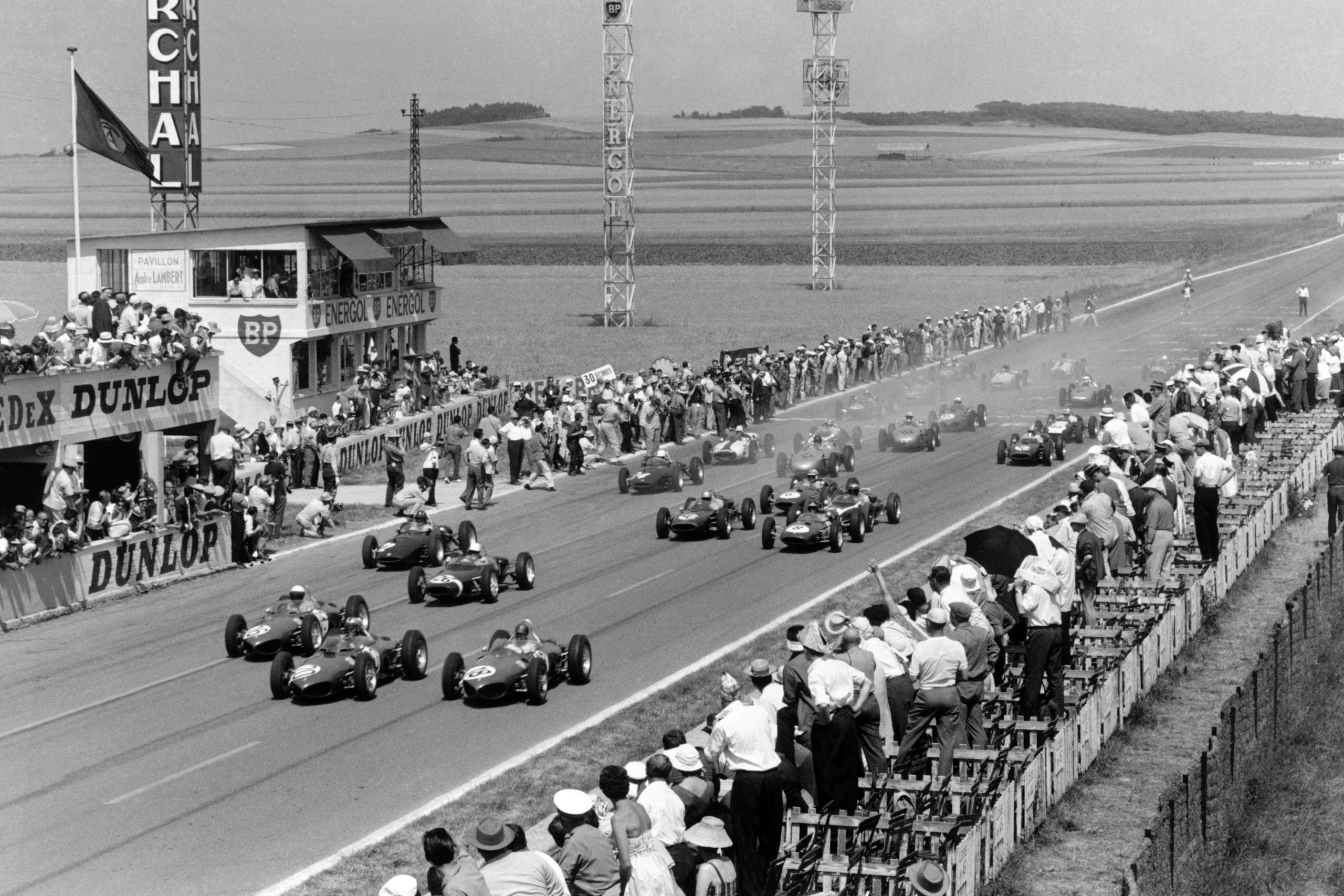 Wolfgang von Trips (#20) leads Phil Hill (#16), Richie Ginther (#18, all Ferrari 156) at the start of the race.