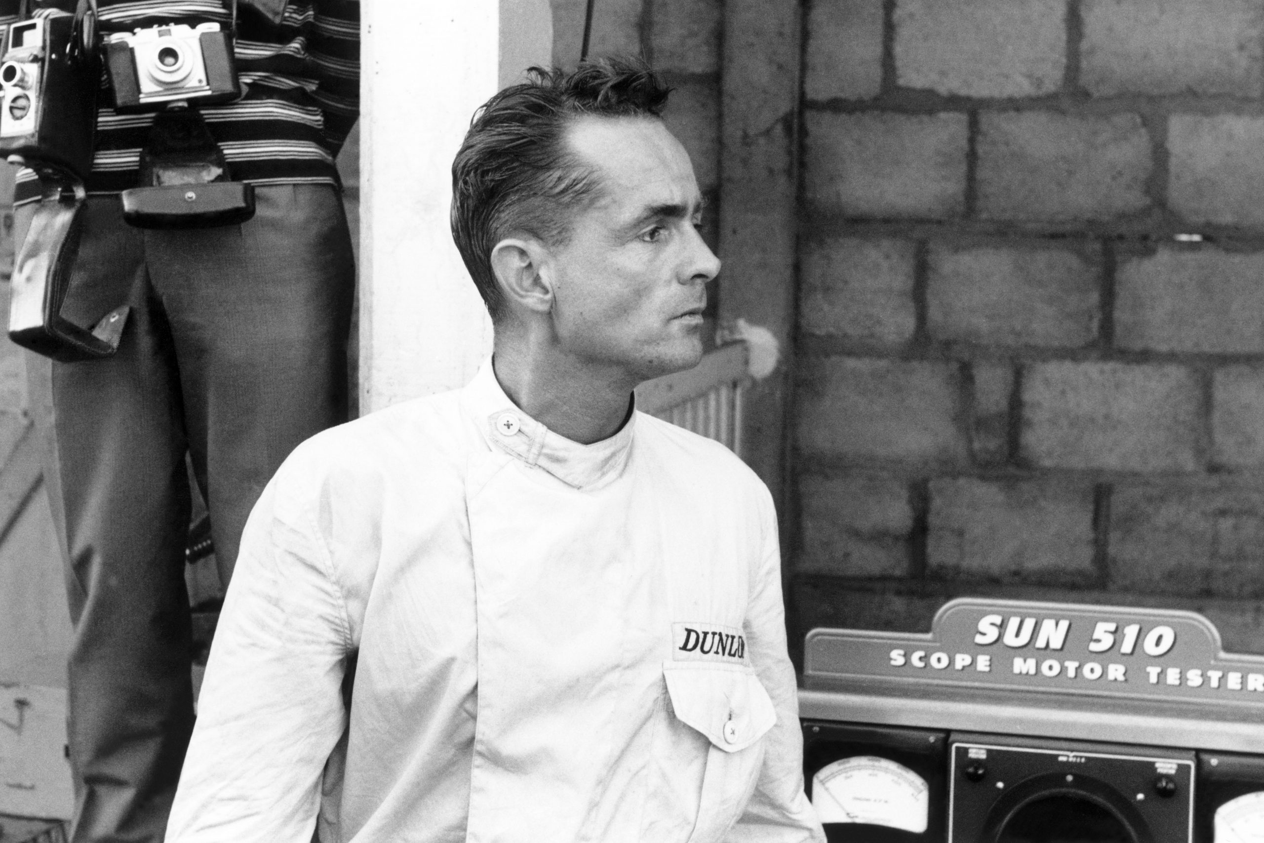 Ferrari 156 driver Phil Hill waits in the pits.