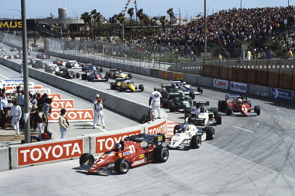 Patrick Tambay (Ferrari 126C2B), Keke Rosberg (Williams FW08C Ford), Jacques Laffite (Williams FW08C Ford), René Arnoux (Ferrari 126C2B), and Michele Alboreto (Tyrrell 011 Ford), lead at the start.