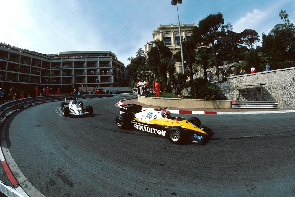 Eddie Cheever in a Renault RE40, leads Jacques Laffite in his Williams FW08C.