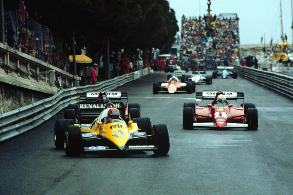 Front row man Rene Arnoux and team mate Patrick Tambay hound Eddie Cheever in the first few laps.