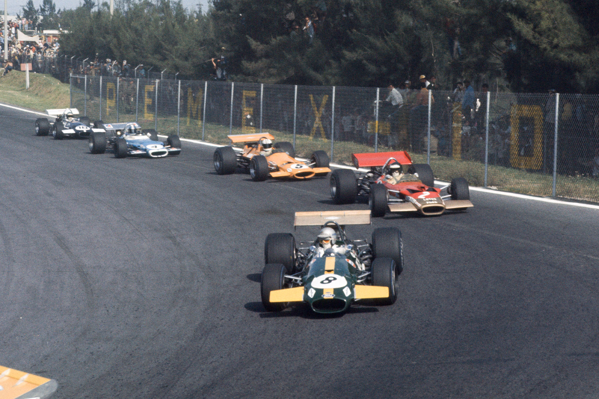 Jack brabham leads the field at the start of the 1969 Mexican Grand Prix.