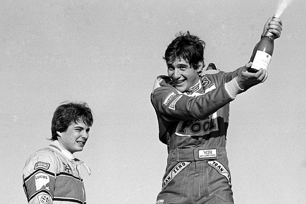 Ayrton Senna sprays the champagne into the air in delight as he celebrates both race and championship victory.