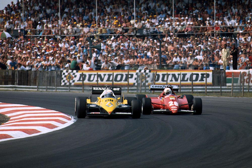 Alain Prost (Renault RE40) goes past the Ferrari of Rene Arnoux.