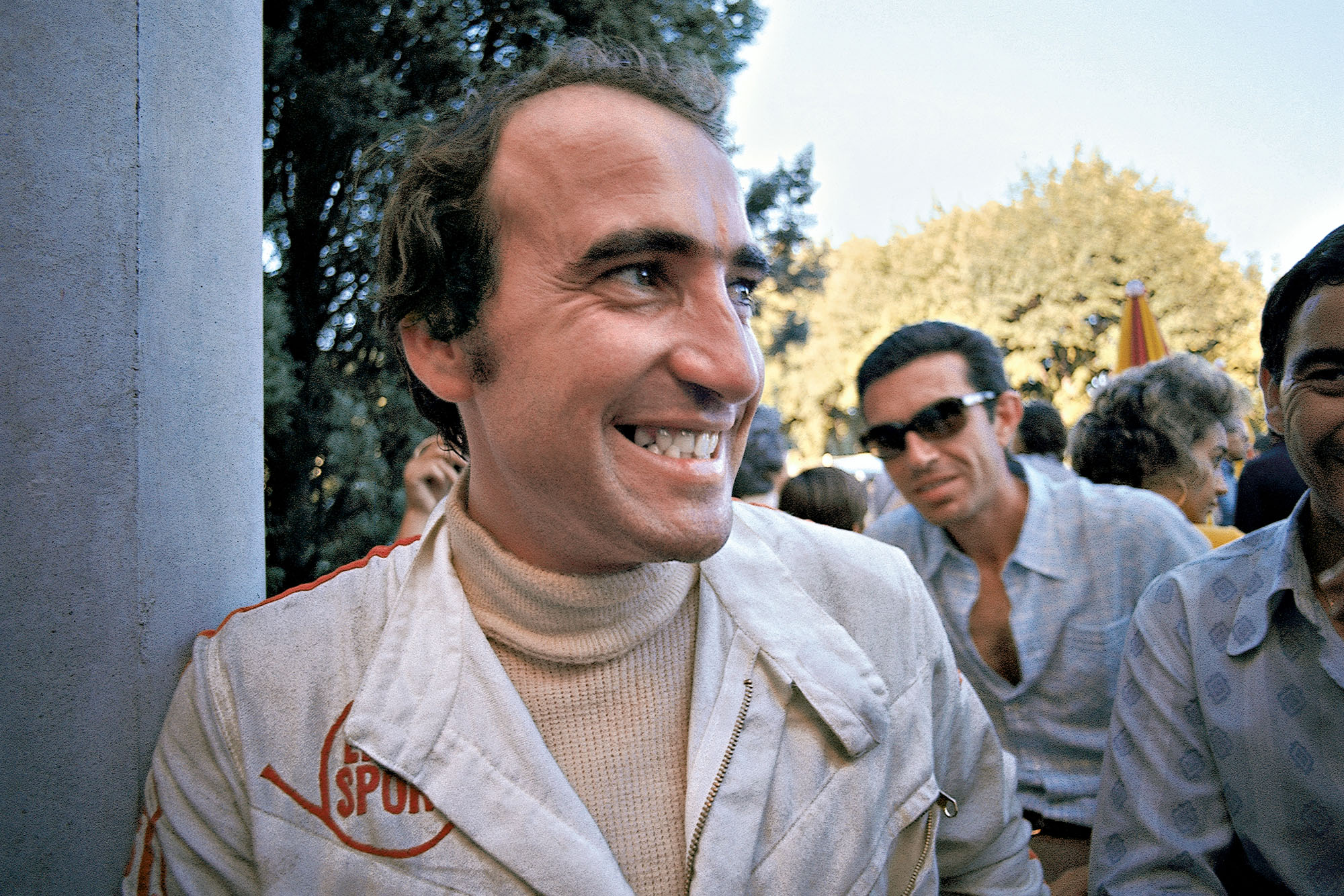 Clay Regazonni is all smiles after winning the 1970 Italian Grand Prix for Ferrari.