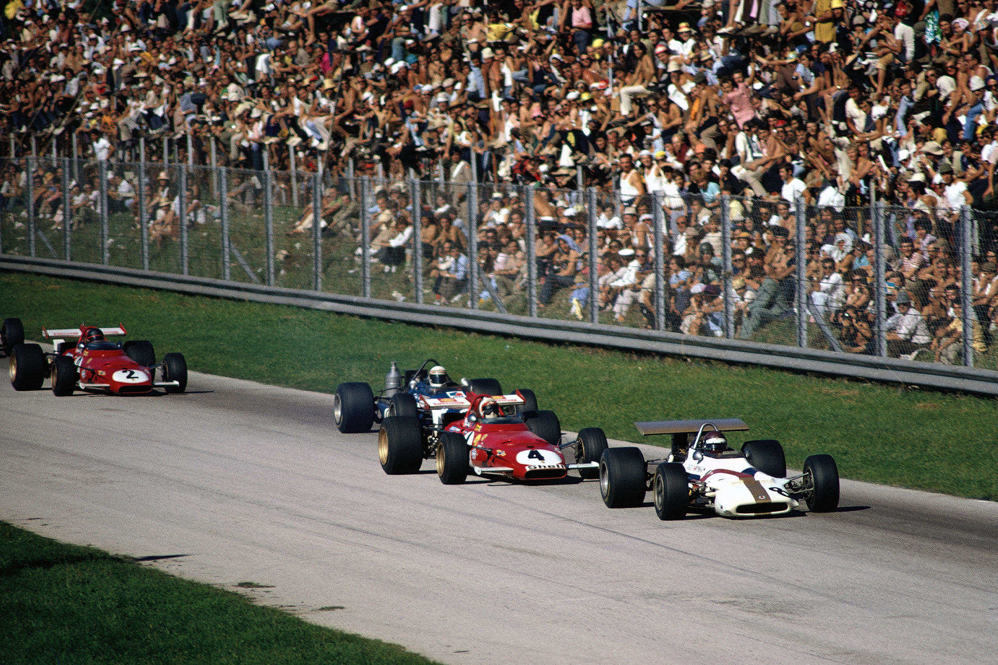 Italian GP 1970: Jackie Oliver, BRM P153 leading Clay Regazzoni, Ferrari 312B, Jackie Stewart, March 701 Ford and Jacky Ickx, Ferrari 312B.