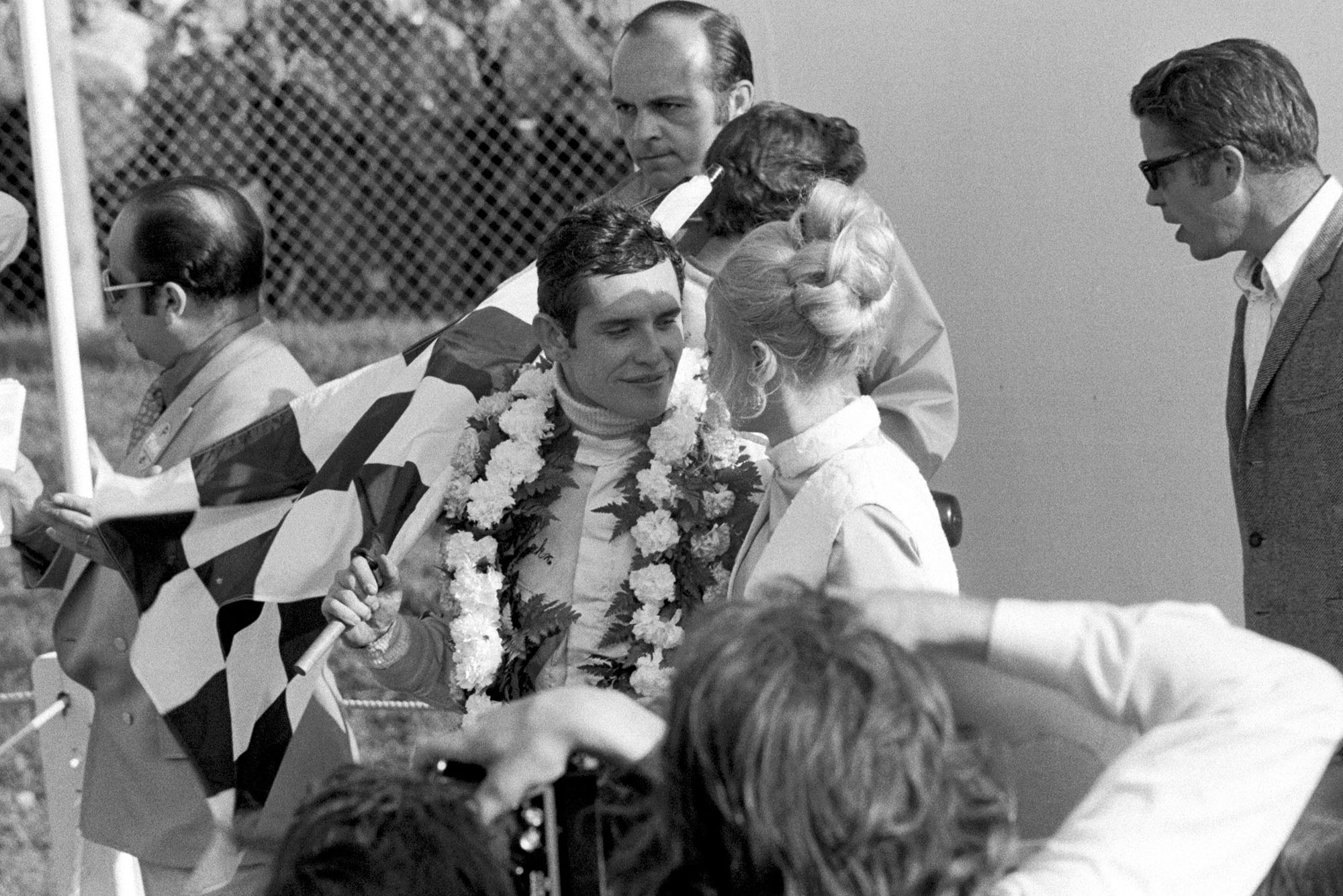 Jacky Ickx celebrates on the podium afterw inning the 1970 Canadian Grand Prix