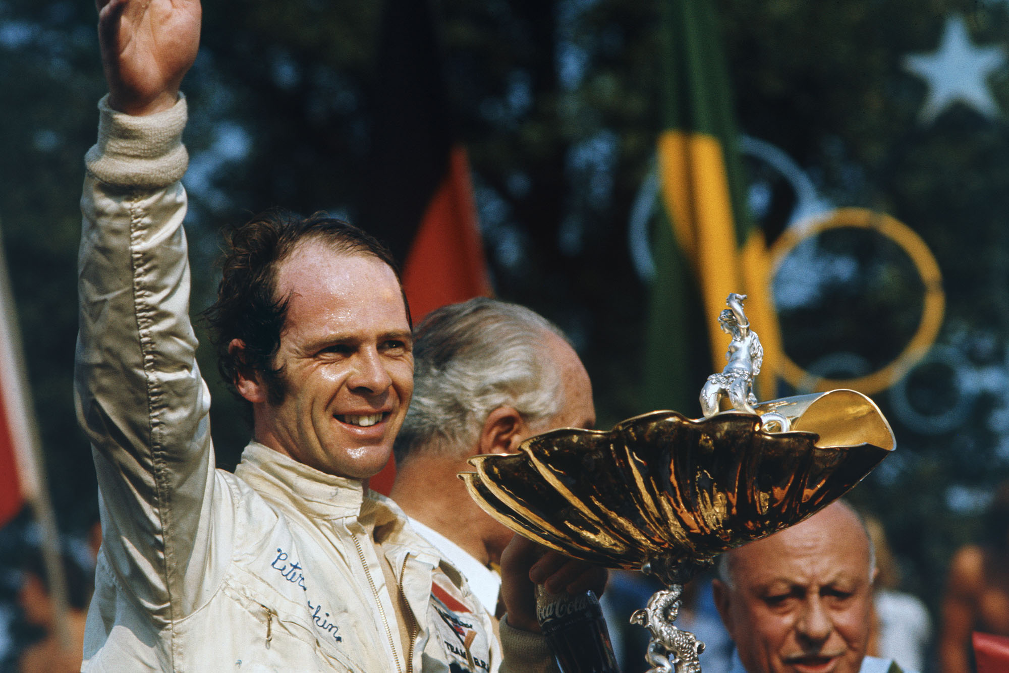 BRM's Peter Gethin celebrates his debut win on the podium at the 1971 Italian Grand Prix