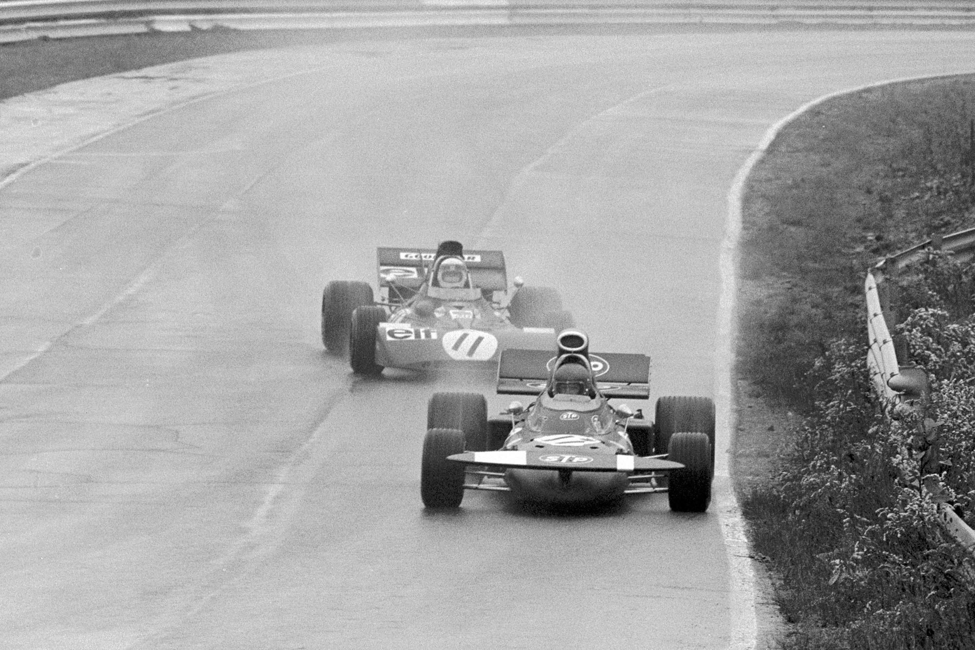 March's Ronnie Peterson and Tyrrell's Jackie Stewart fight it out for the lead.