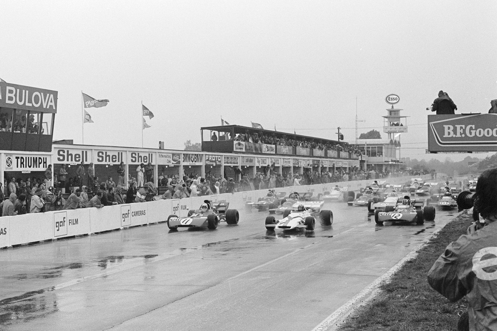 Cars tentatively pull away as the 1971 Canadian Grand Prix starts in treacherous conditions