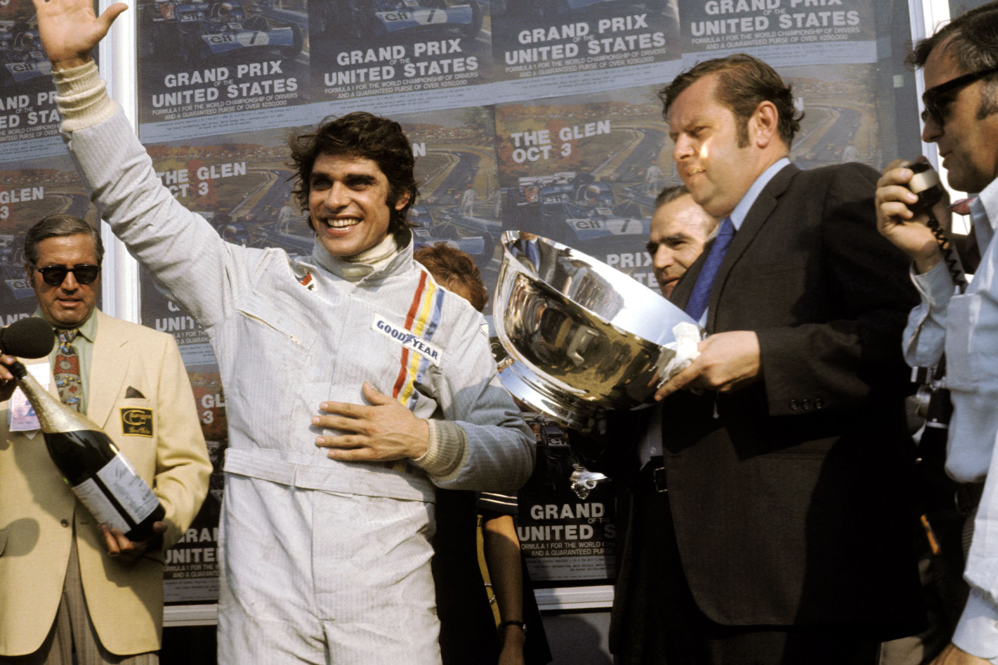 Francois Cevert celebrates his first win on the podium at the 1971 United States Grand Prix.
