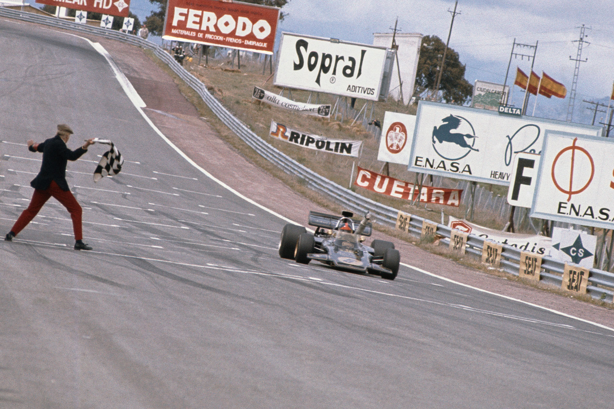 Emerson Fittipaldi takes the chequered flag to win the 1972 Spanish Grand Prix