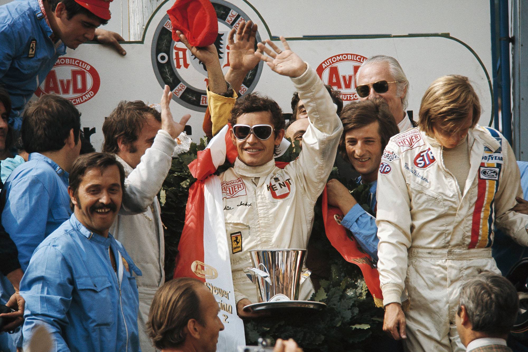 Ferrari's Jacky Ickx waves from the podium after winning the 1972 German Grand Prix, Nurbrugring.