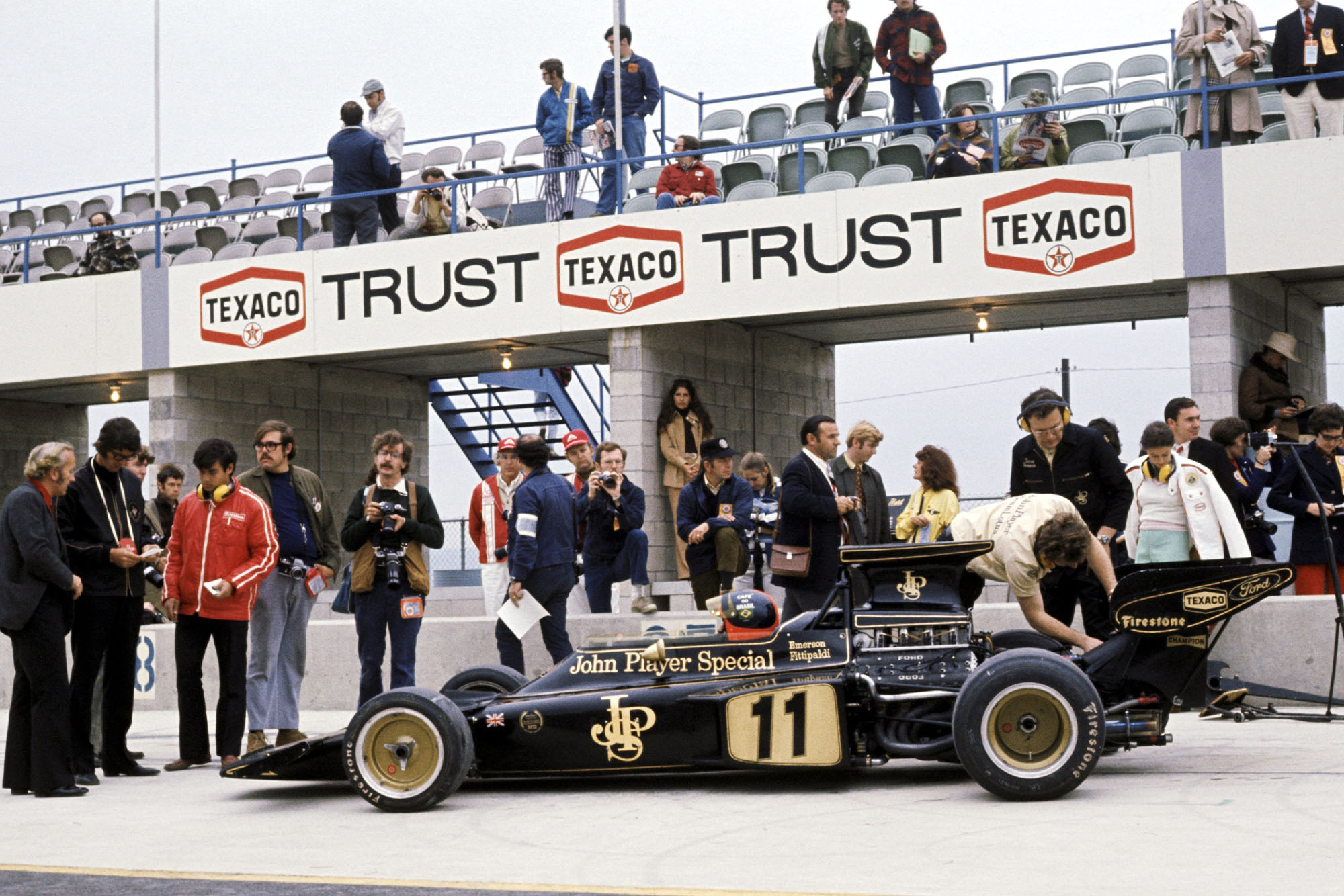 Emerson Fittipaldi sits in his Lotus in the pitlane at the 1972 United States Grand Prix, Watkins Glen.