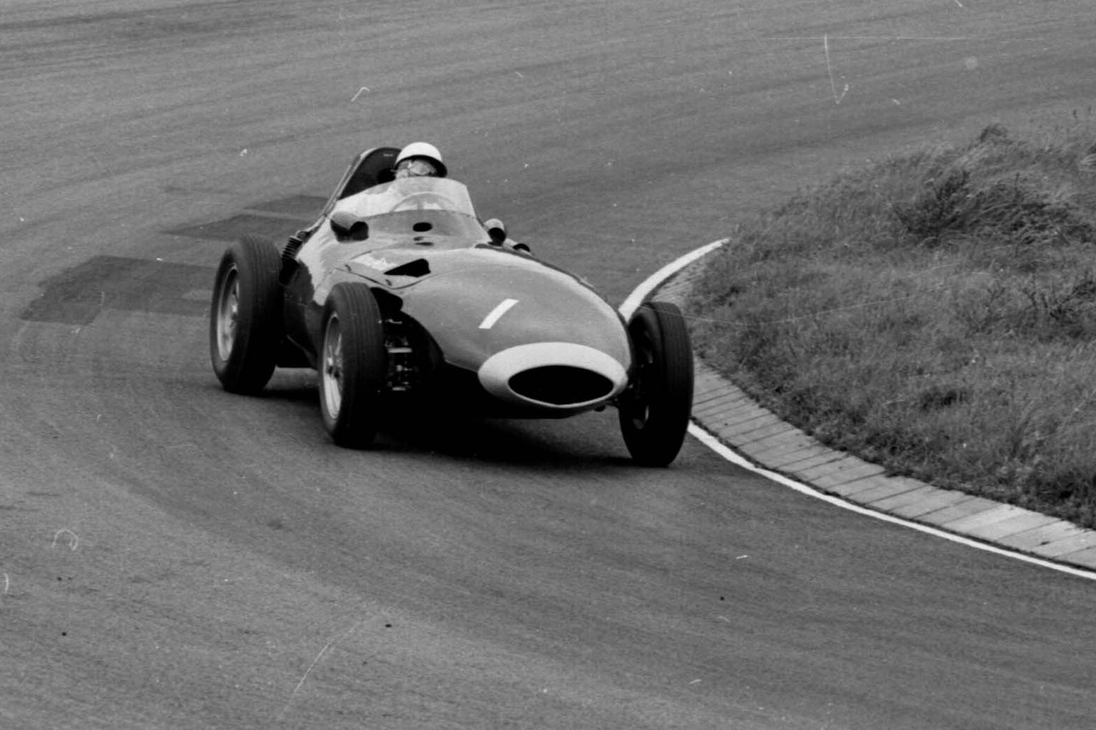 Stirling Moss in 1st postion driving the Vanwall