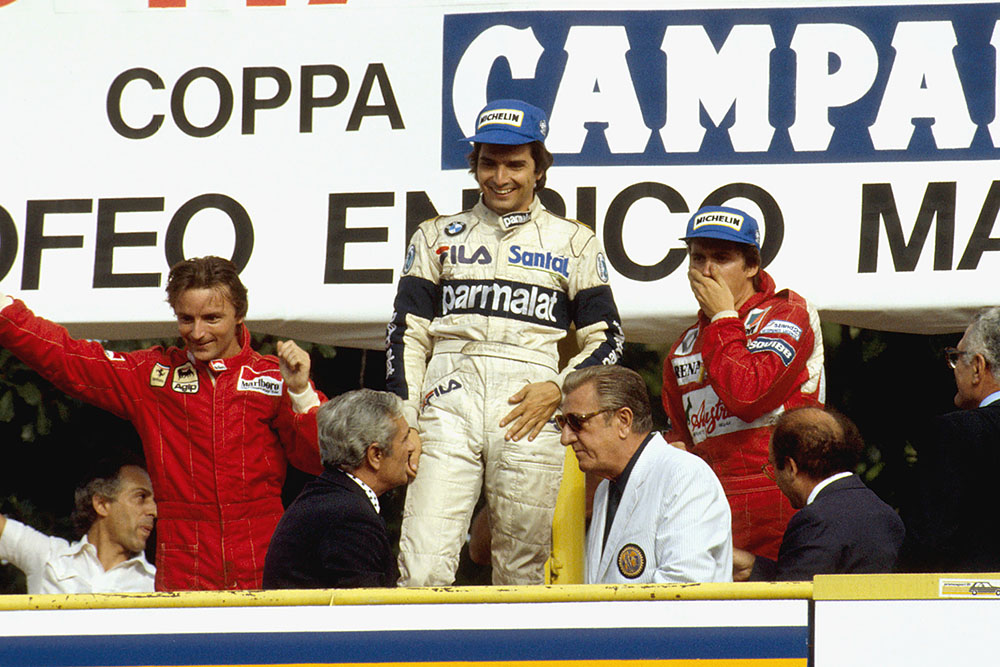 Nelson Piquetfinished 1st, Rene Arnoux 2nd and Eddie Cheever 3rd position on the podium. FIA President Jean-Marie Balestre stands at the front.