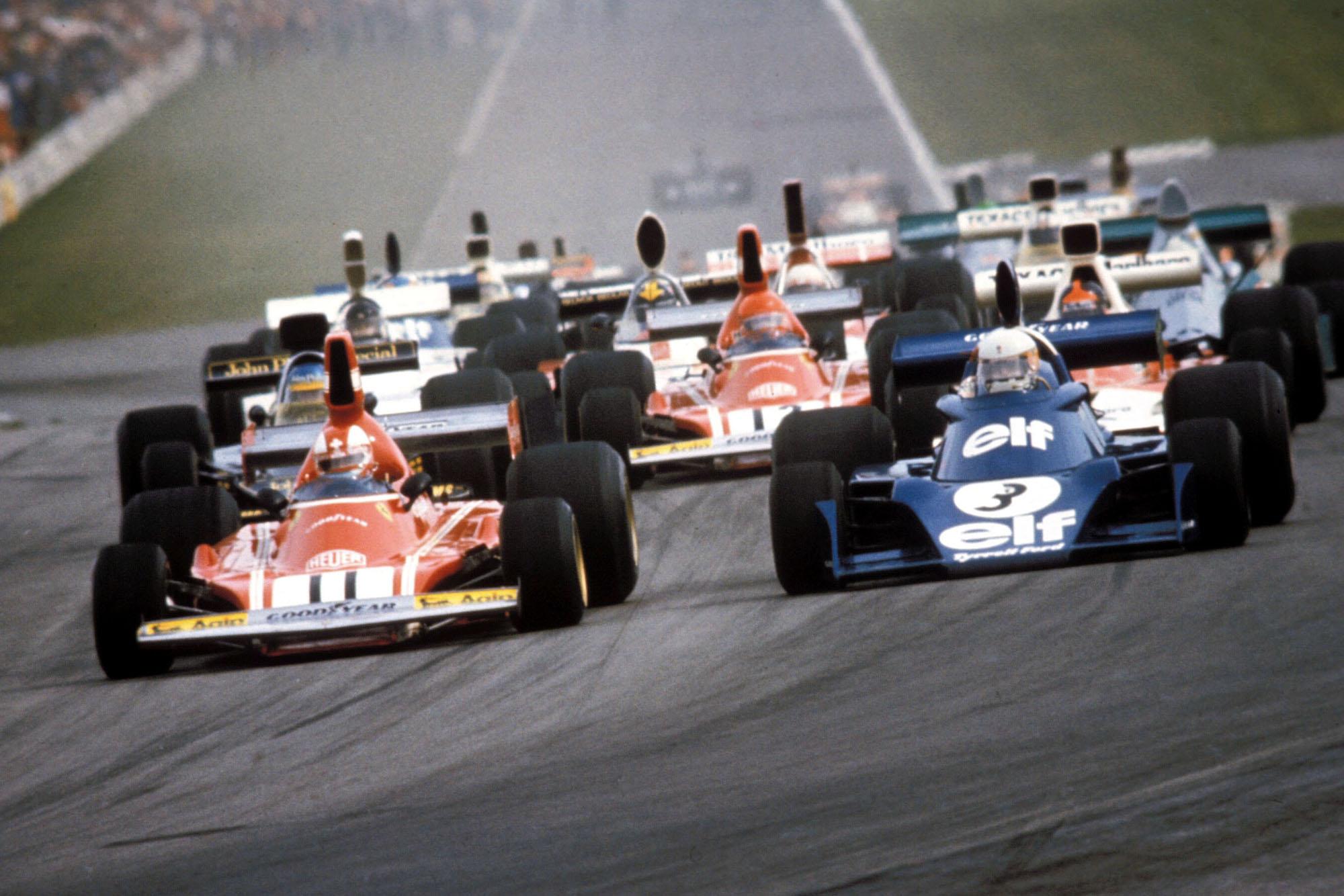 Clay Regazzoni (Ferrari) leads into the first corner of the 1974 Belgian Grand Prix, Zolder.