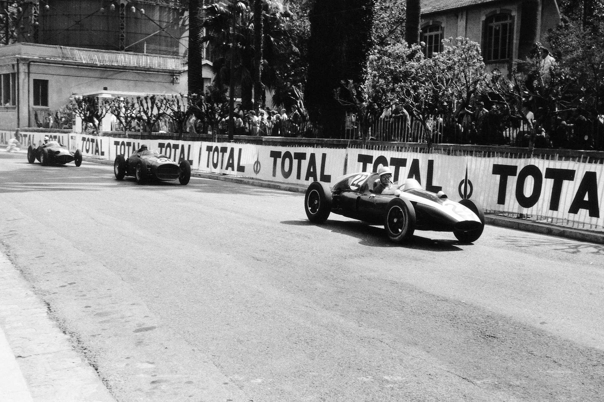 Bruce McLaren in a Cooper T51-Climax leads Tony Brooks in his Ferrari Dino 246 and Harry Schell driving a BRM P25