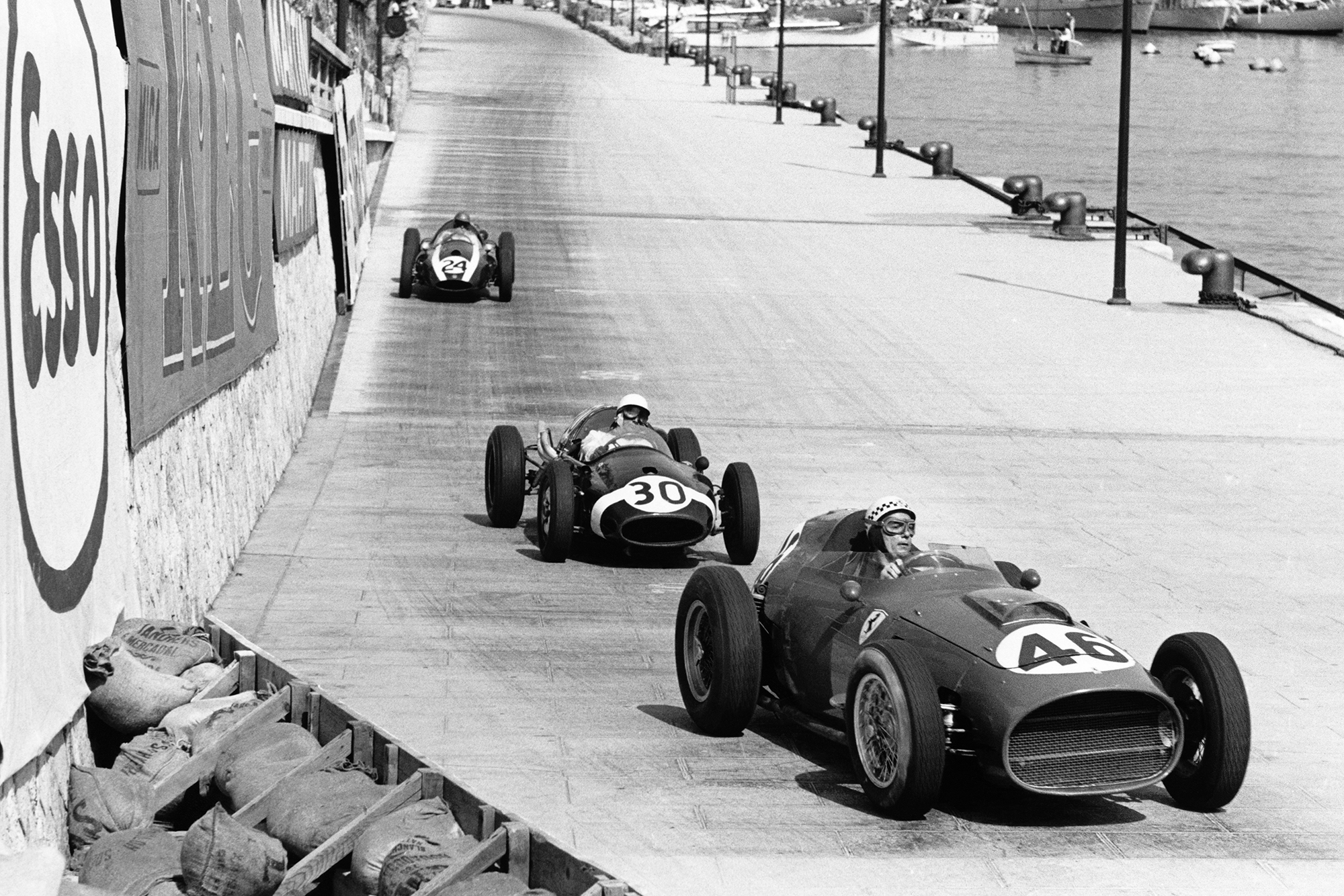 Jean Behra in his Ferrari Dino 246 leads Stirling Moss in a Cooper T51-Climax and Jack Brabham also in aCooper T51-Climax.