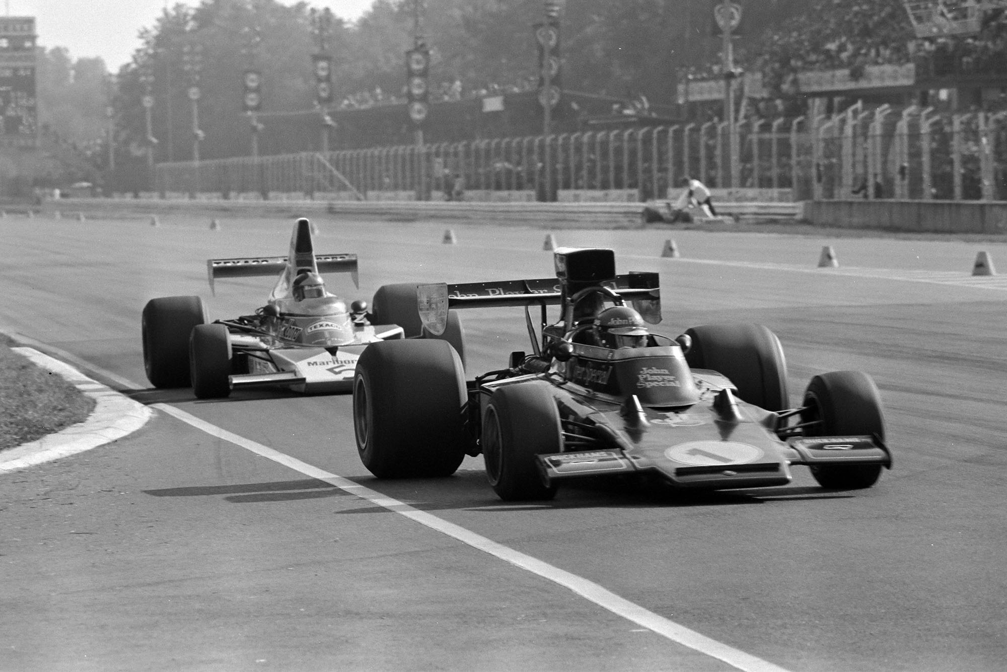 Ronnie Peterson (Lotus) leads Emerson Fittipaldi (McLaren) at the 1974 Italian Grand Prix, Monza.)