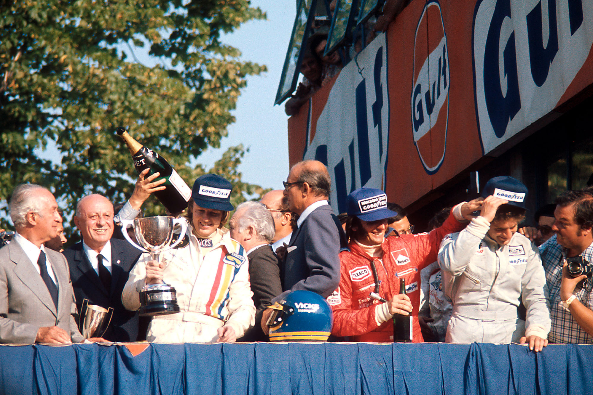 Ronnie Peterson celebrates on the podium at the 1974 Italian Grand Prix, Monza.