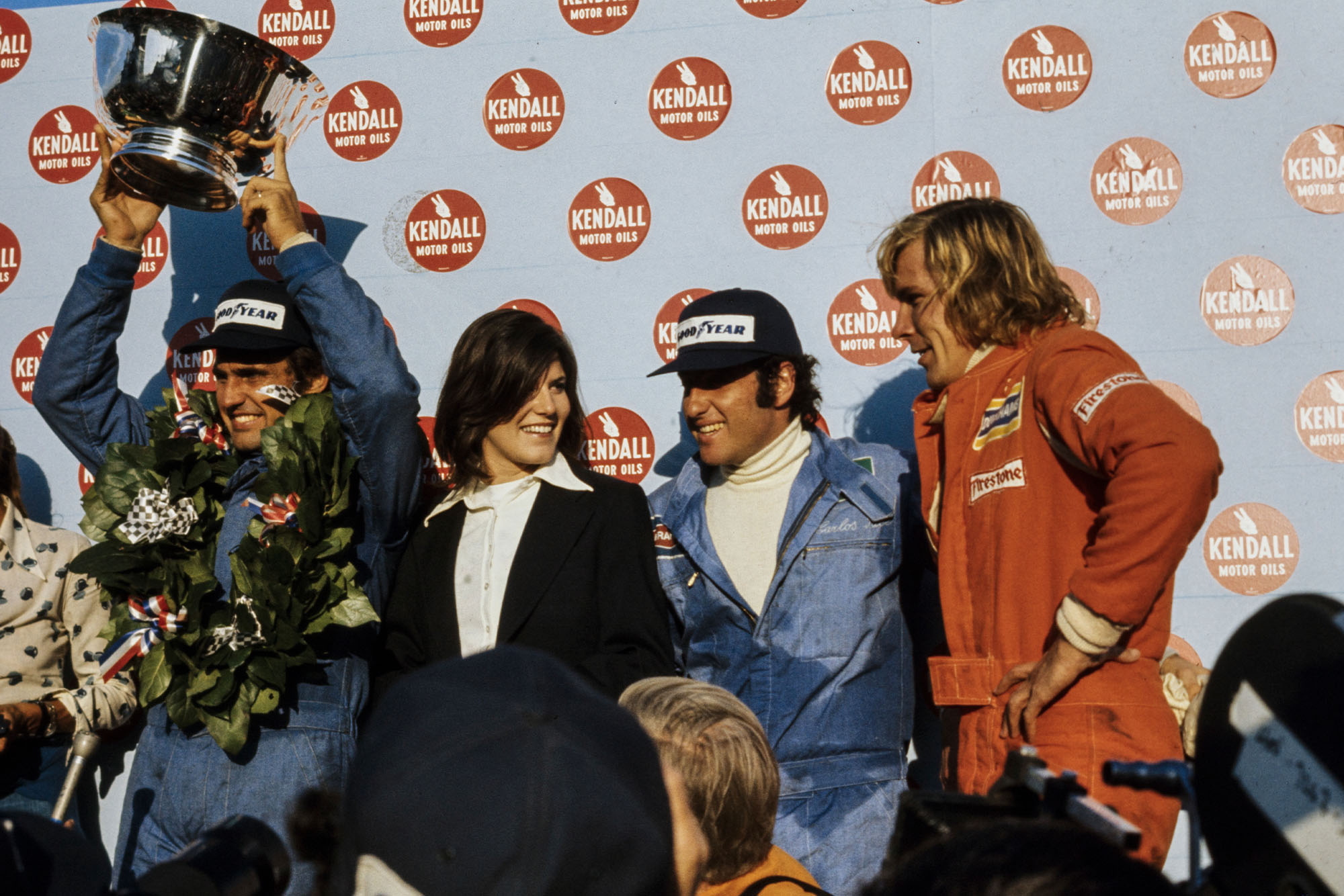 Carlos Reutemann (Brabham) celebrates on the podium.
