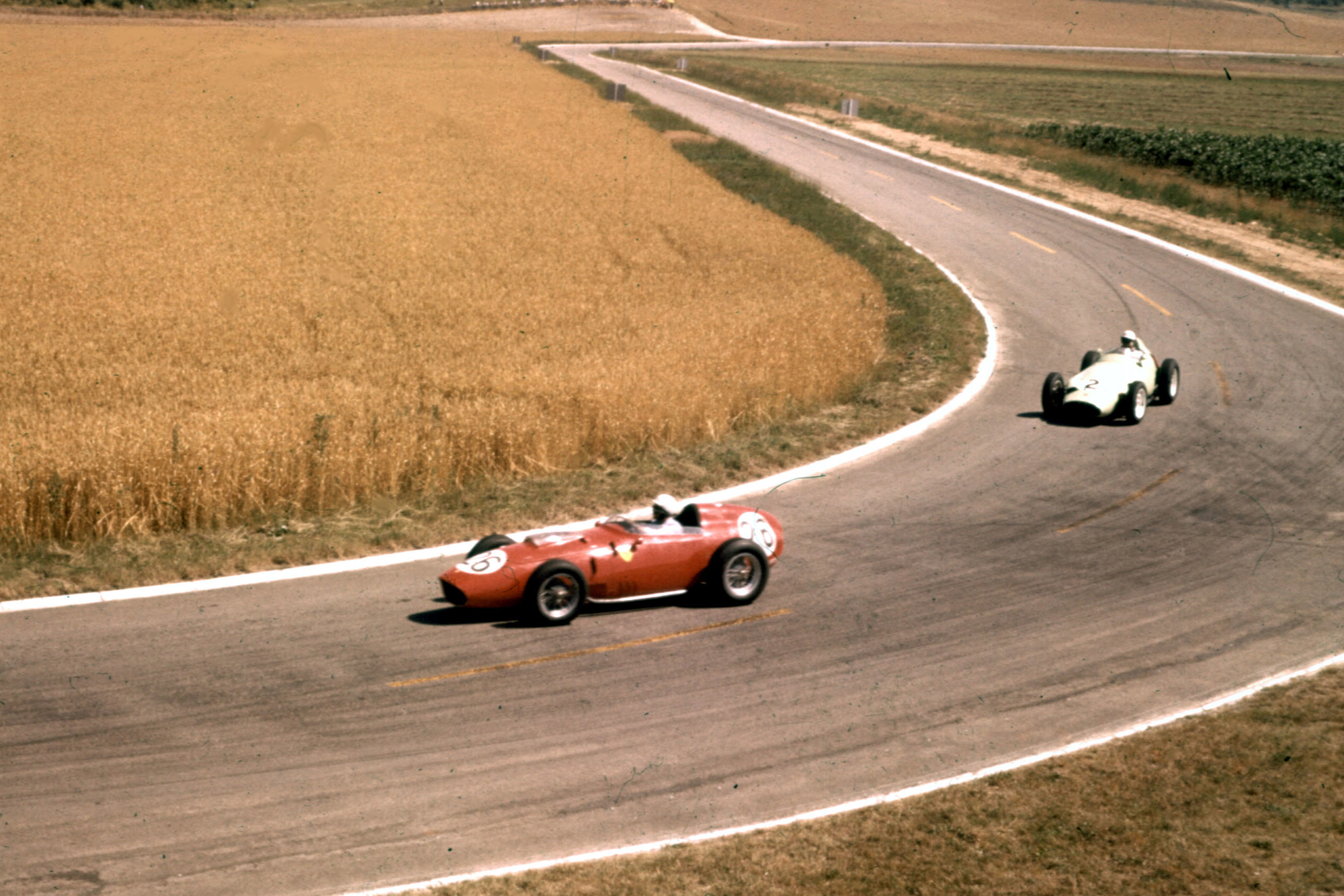 Phil Hill who finished 2nd in a Ferrari Dino 246 leads Stirling Moss in his BRM P25.