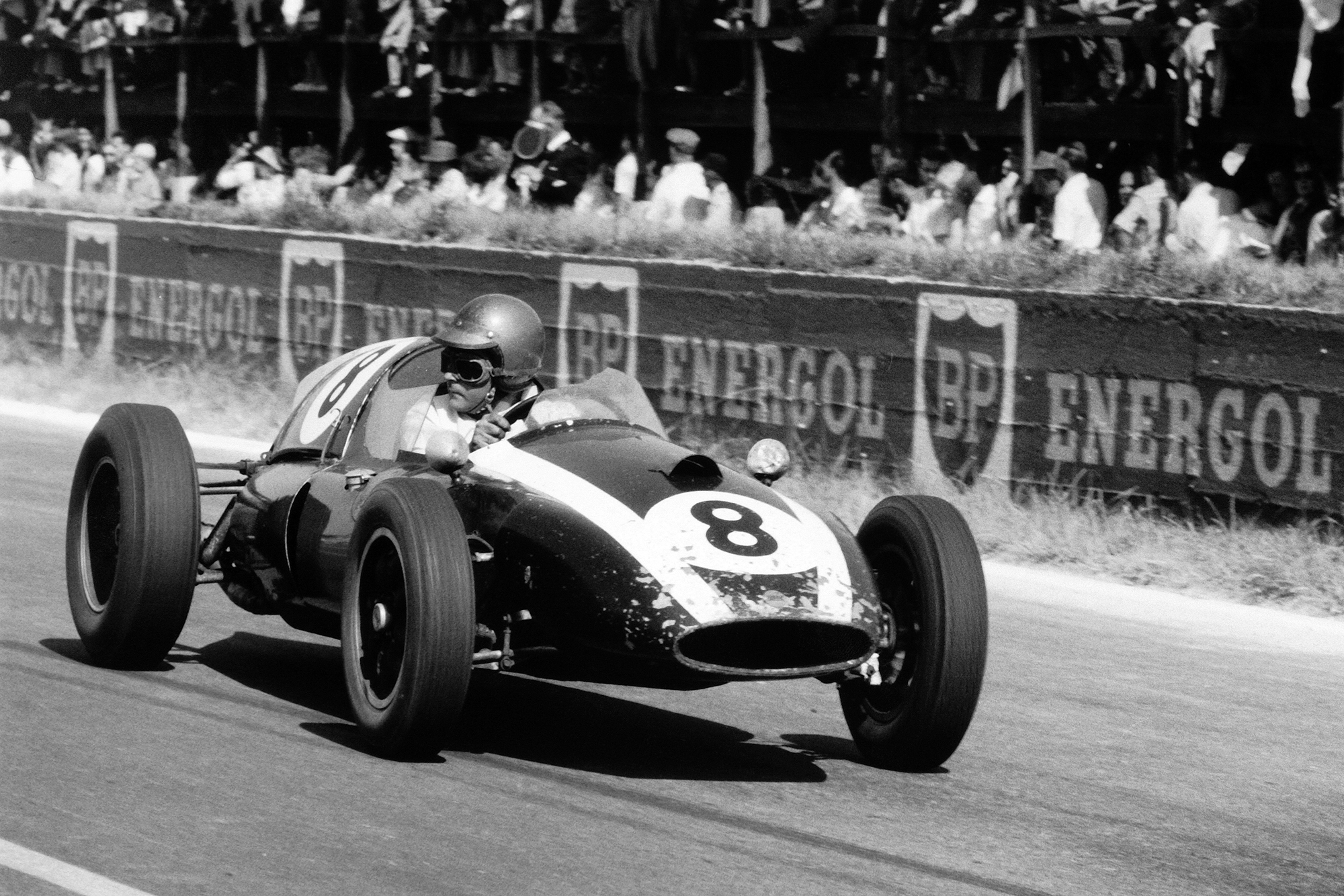 Jack Brabham driving his Cooper T51-Climax to 3rd position.