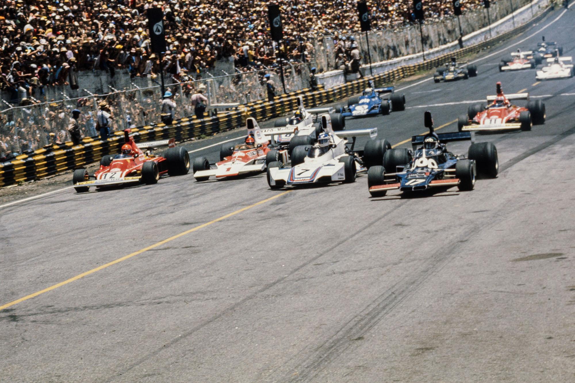 (From right) Jean-Pierre Jarier heads Carlos Pace, Emerson Fittipaldi and Niki Lauda at the 1975 Brazailian Grand Prix, Interlagos.