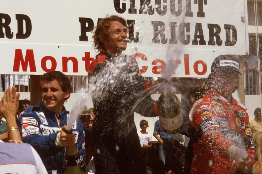 Rene Arnoux, 1st position, Alain Prost, 2nd position and Didier Pironi, 3rd position on the podium.