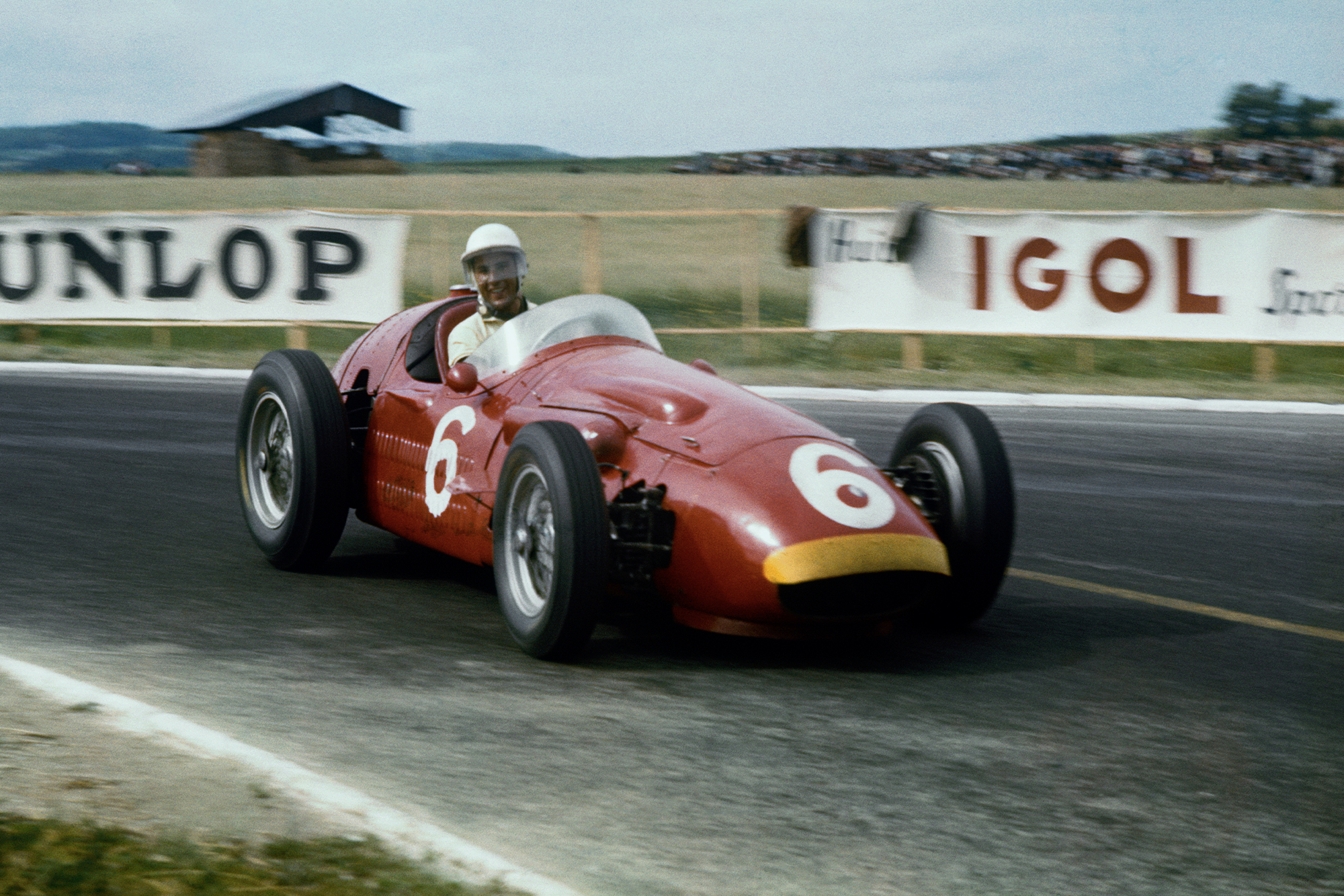 Stirling Moss (Maserati 250F), on his way to 5th place at the 1956 French Grand Prix, Reims.