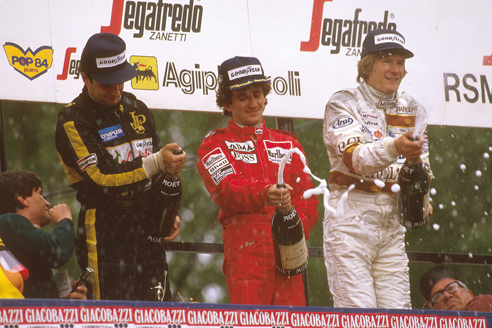 Alain Prost, 1st position but later disqualified due to the car being under weight at the finish, Elio de Angelis 1st position, and Thierry Boutsen 2nd position, on the podium.