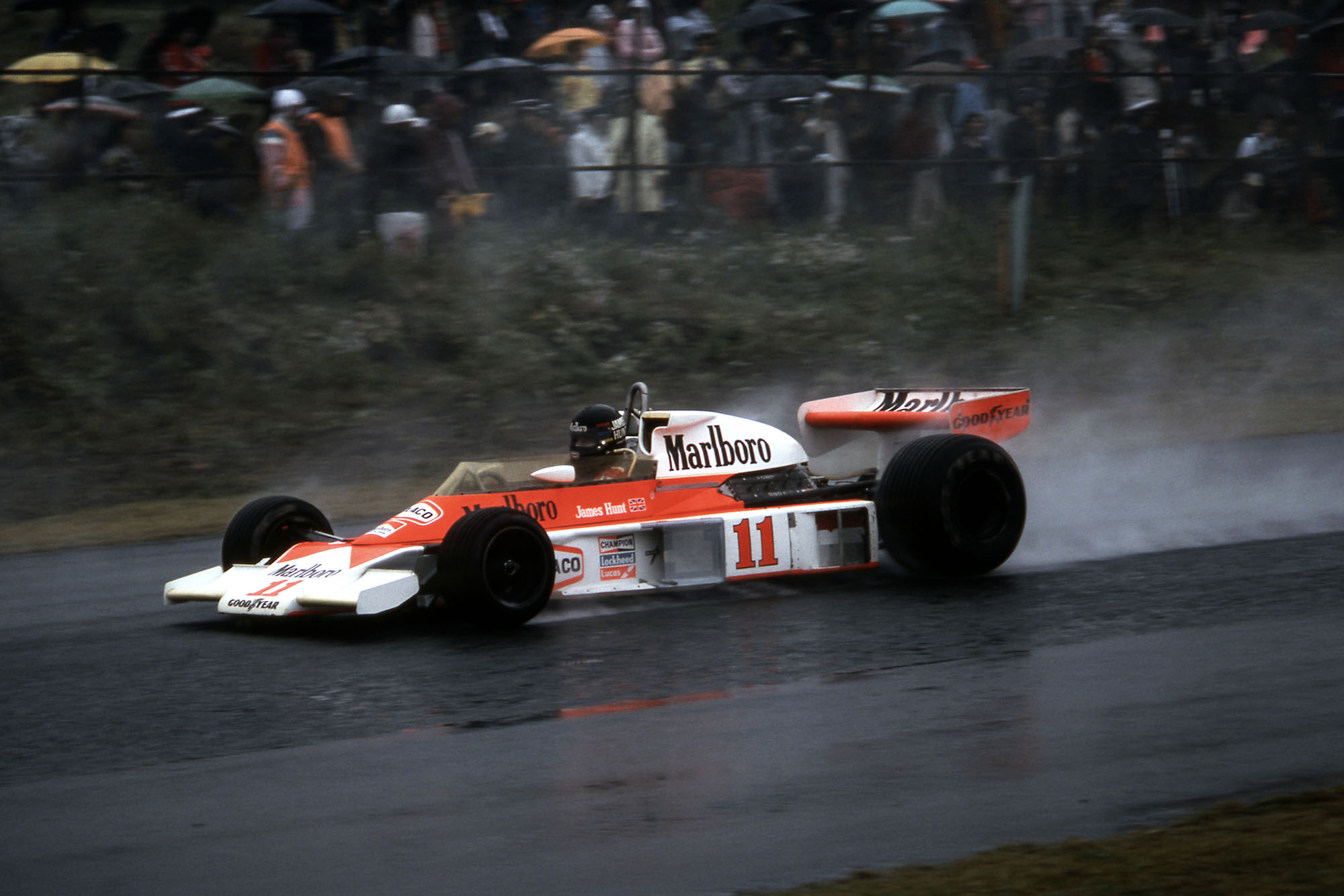 James Hunt driving his McLaren in wet conditions at the 1976 Japanese Grand Prix, Fuji.