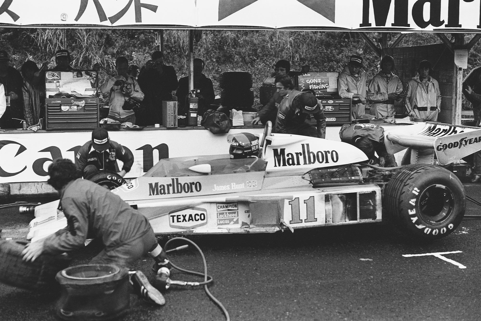 James Hunt (McLaren) pulls in for a pit-stop at the 1976 Japanese Grand Prix, Fuji.