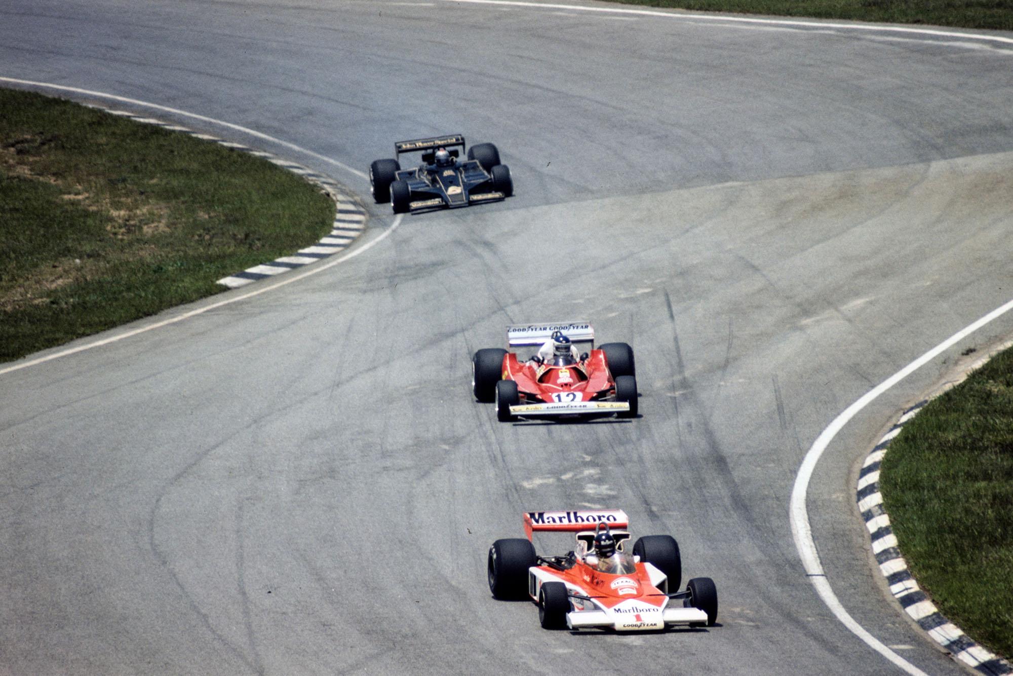 James Hunt (McLaren) leads Carlos Reutemann (Ferrari) and Mario Andretti (Lotus), 1977 Brazilian Grand Prix, Interlagos.