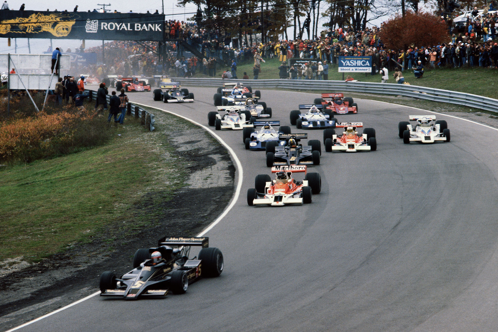 Mario Andretti (Lotus) leads the field on lap 1 at the 1977 Canadian Grand Prix, Mosport Park.