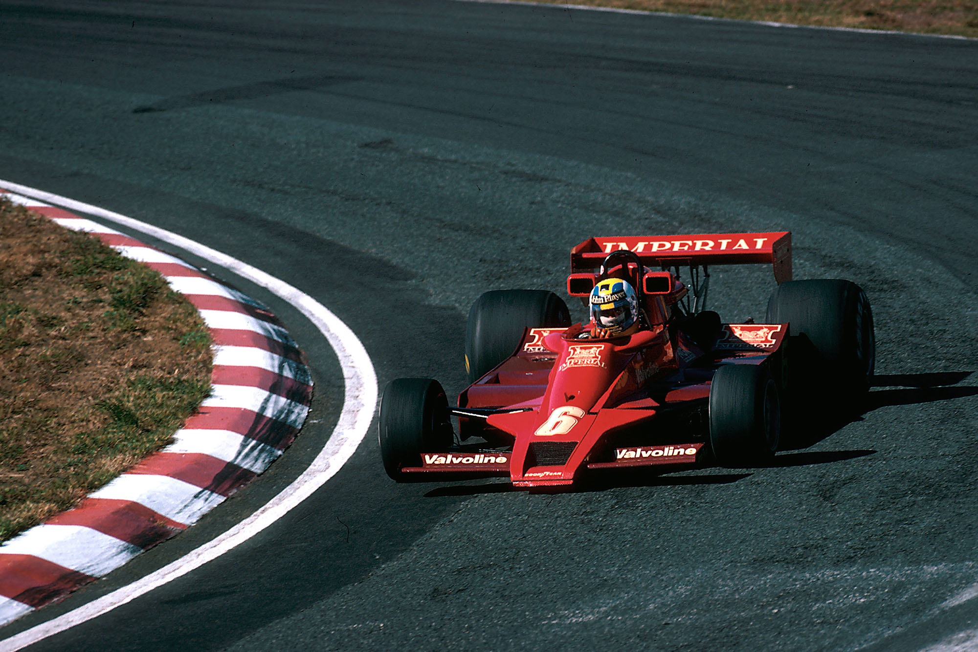 Gunnar Nilsson (Lotus) running a one-off red Imperial Tobacco livery, 1977 Japanese Grand Prix, Fuji.