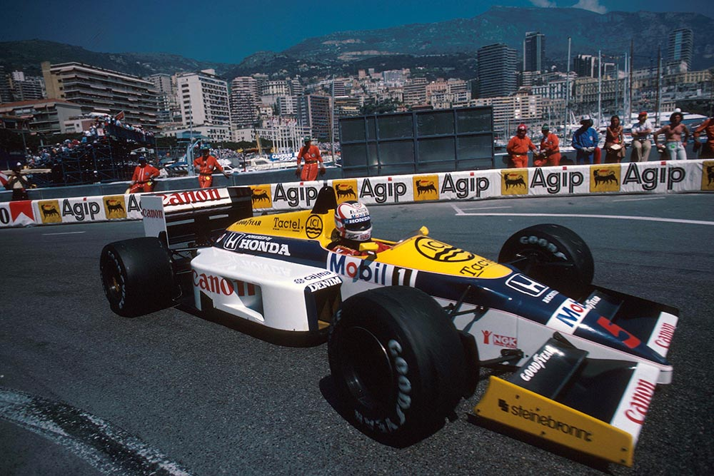 Nigel Mansell driving his Williams FW11 to 4th place.