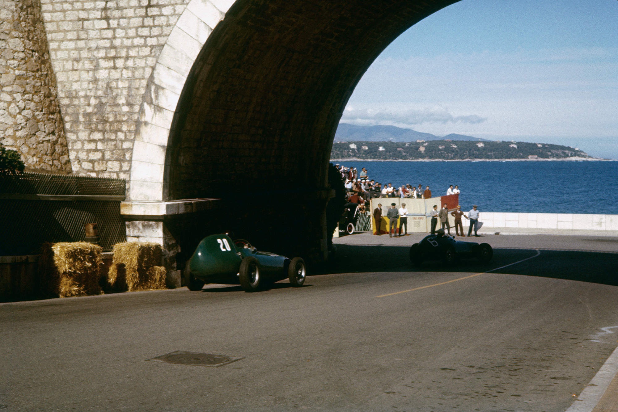 Tony Brooks and Ron Flockhart get a glimpse of the sea as they head down to the tunnel during the 1957 Monaco Grand Prix.