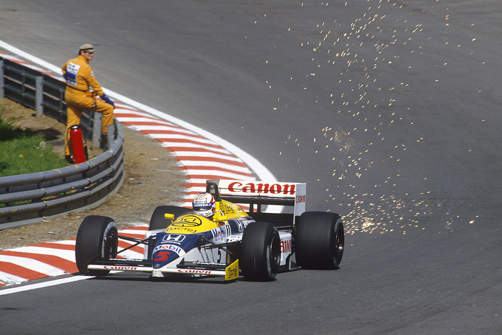 Nigel Mansell showers sparks at Eau Rouge in his Williams FW11 Honda.