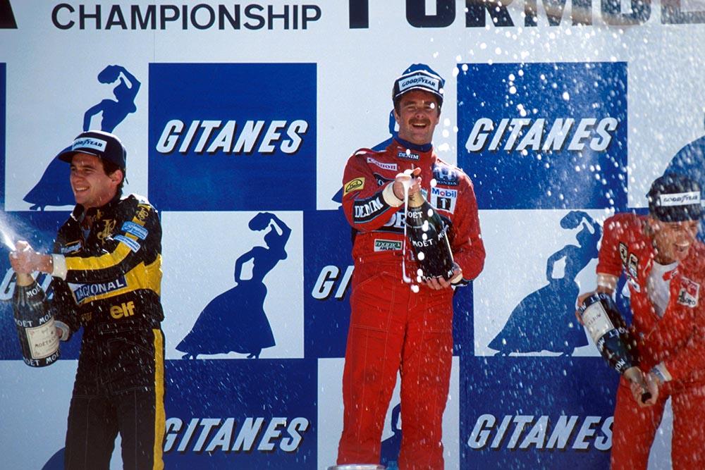 Ayrton Senna, 2nd; Nigel Mansell, winner; Stefan Johansson, 3rd, on the podium.
