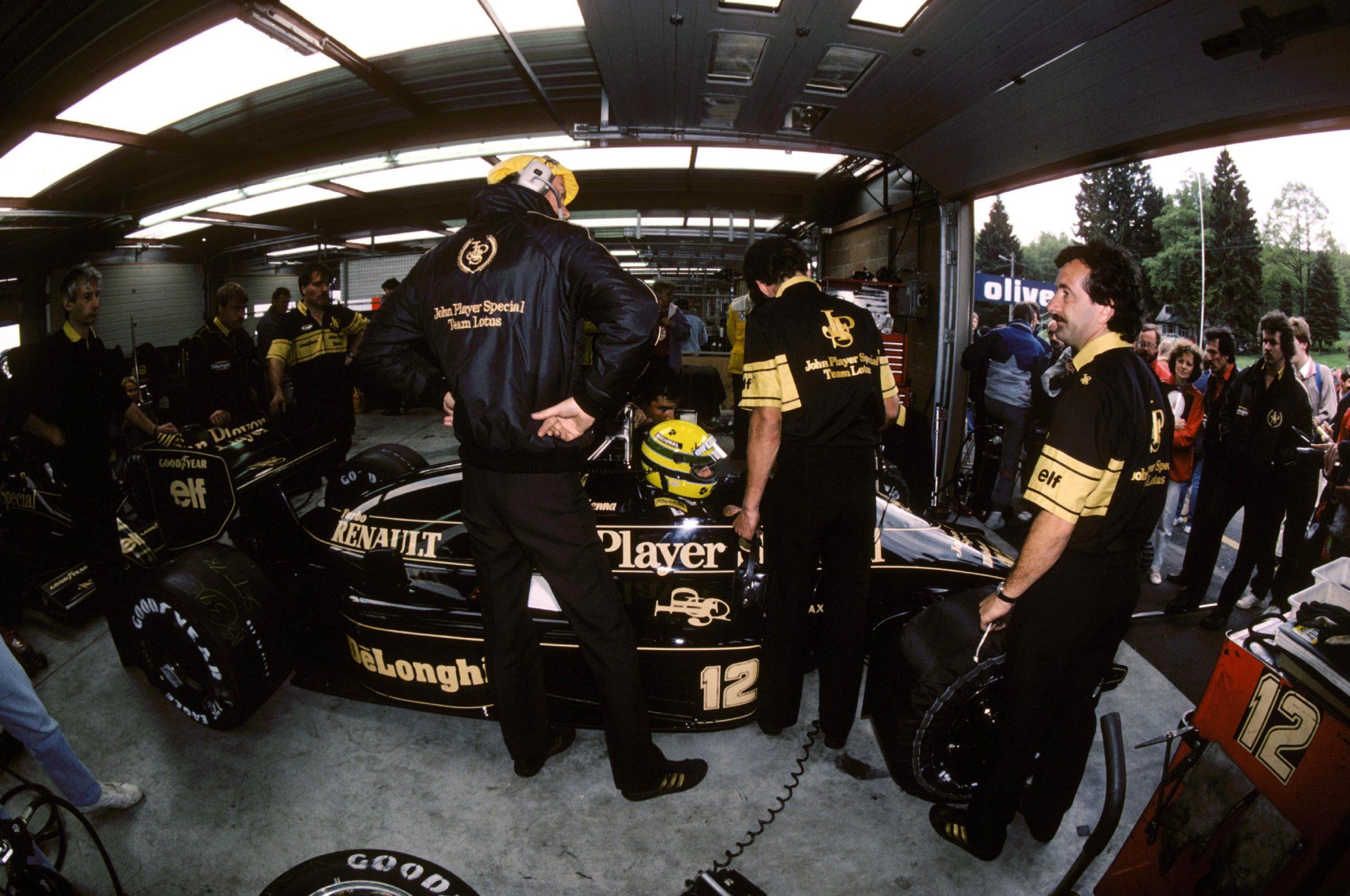 Ayrton Senna sits in the Lotus garage.